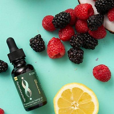 Full-Spectrum Hemp Oil tincture next to fruit